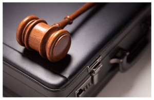 judges gavel on top of a briefcase
