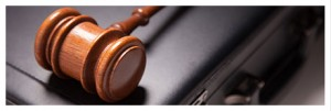 wooden gavel and briefcase