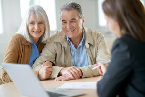 elderly couple meeting with an estate planner