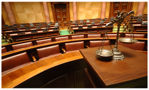 empty courtroom and justice scales